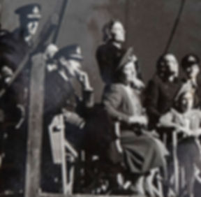 """The visit of King George VI, Queen Elizabeth & Princess Margaret (seated) to the set of """"In Which We Serve"""" at Denham Film Studios. Mountbatten & Edwina can be seen standing behind The King & Queen"""