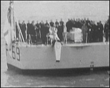 Edwina's coffin is lowered into the sea from HMS Wakeful ​
