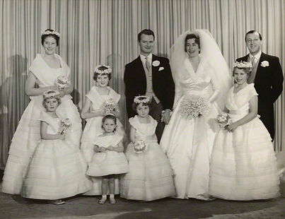 David Hicks & Pamela with their bridesmaids (including Princess Anne on the right), and best man - John, 7th Lord Brabourne (far right) ​