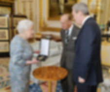 Queen Elizabeth II awarding Philip the insignia of a Knight of the Order of Australia (AK)   