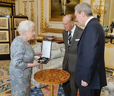 Queen Elizabeth II awarding Philip the insignia of a Knight of the Order of Australia (AK)   ​