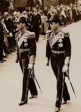 George's cousins -  King George VI and his brother - Prince George, 1st Duke of Kent walking in George's funeral procession