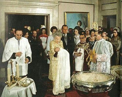 Victoria Eugénie holding her great-grandson - the baby Infante Felipe, later King Felipe VI of Spain at his baptism  