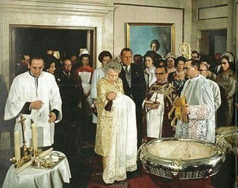 Victoria Eugénie holding her great-grandson - the baby Infante Felipe, later King Felipe VI of Spain at his baptism  ​