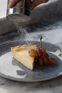 Ricotta & lemon tart served with roasted red grape