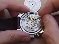 stock-photo-working-on-a-mechanical-watch-372152722.jpg