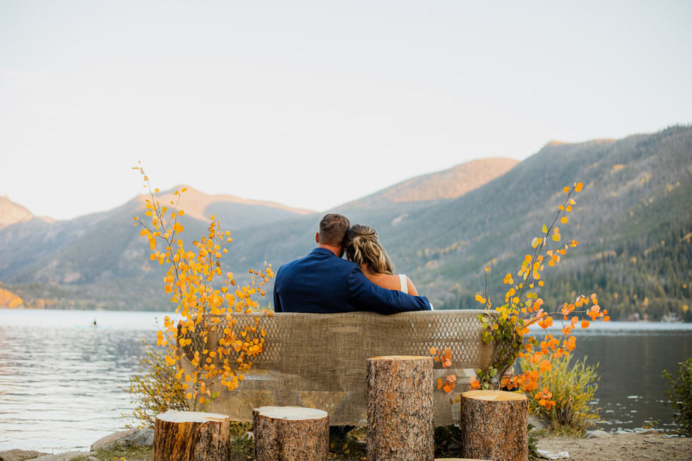couple looking out at grand lake colorado during their fall colorado elopement