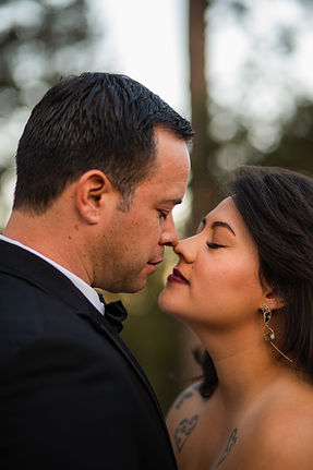 bride and groom touching noses with eyes closed during their colorado wedding portraits