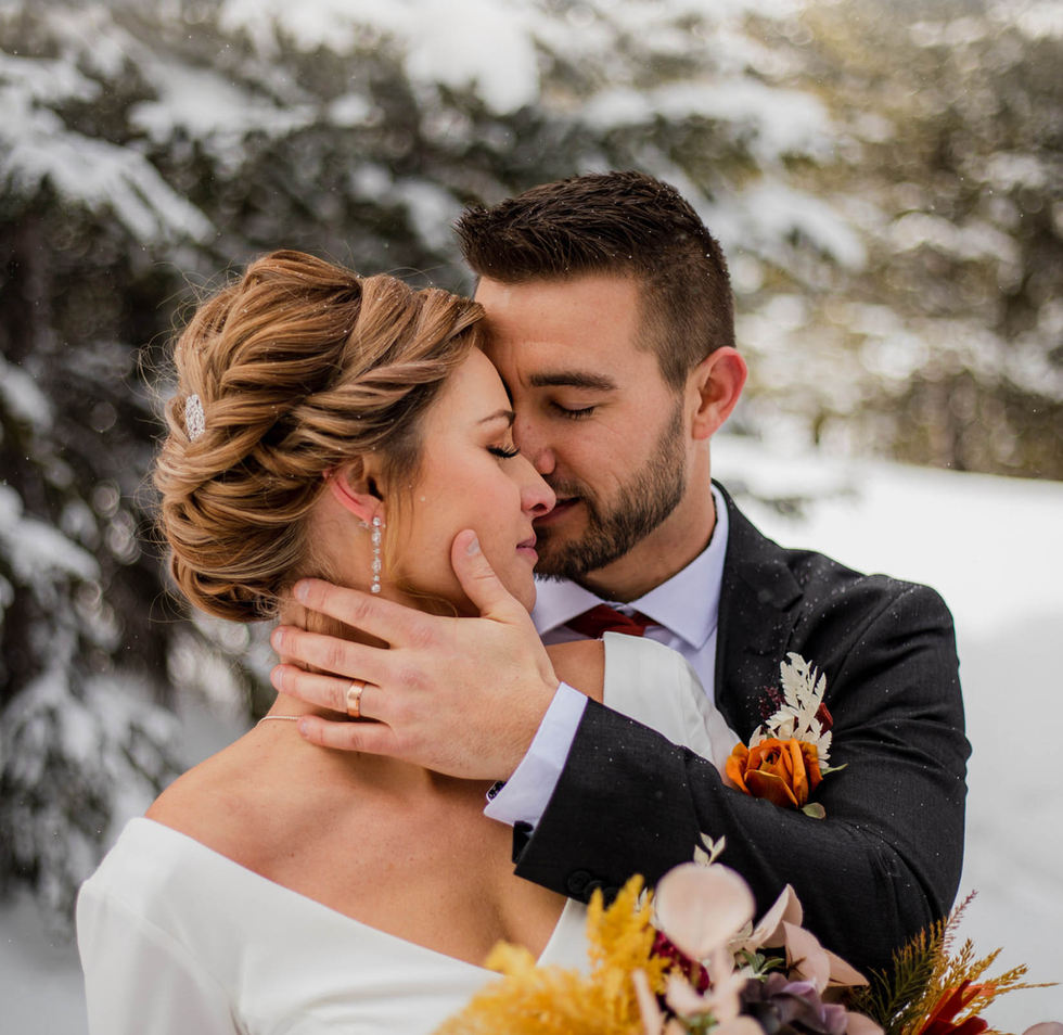 bride and groom embracing during colorado snowshoe winter elopement with Katrina S. Joseph Photography