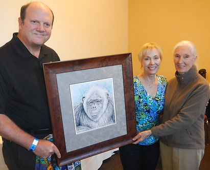 Becci Crowe Presenting her Art to Jane Goodall