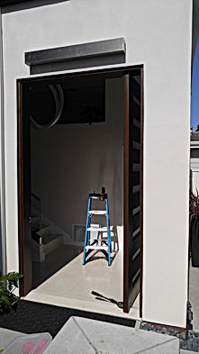 Custom Pivot door repair