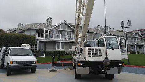 Lifting a door on t a  balcony with a mobile crane for install