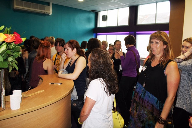 Students in The Yoga Bank reception, with founder Jackie Quayle