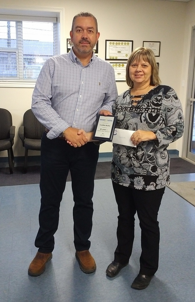 Cyndy Burke receives recognition for 20 years with Capital.