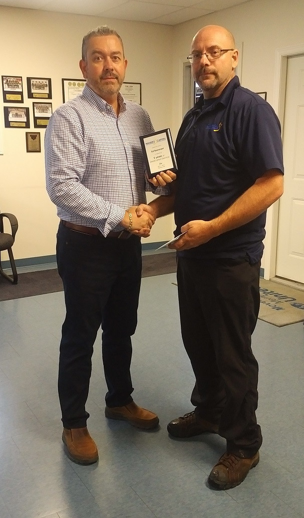 Ed Bammert receives an award for 5 years being a Driver and Lead Mover.