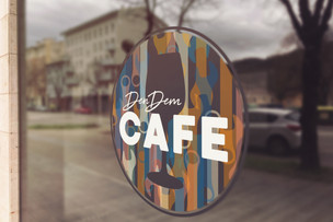 Brand identity/logo design for the bar DenDem Café Vinyl window decoration
