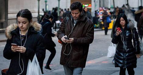 People using their smartphones while walking