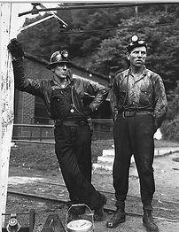 Miner on left wearing overalls