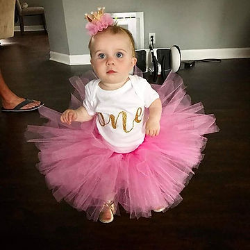 This girl is just too stinkin cute. This fluffy punk tutu is thr psrfrct compliment to the gold glit