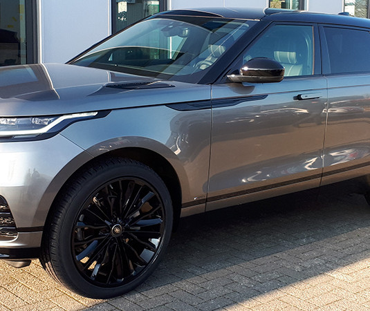 Grey Range Rover Velar on HAWKE Harrier wheels in Black colour finish