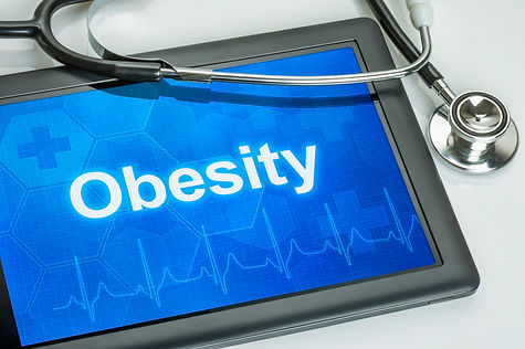 Tablet with the diagnosis obesity on the