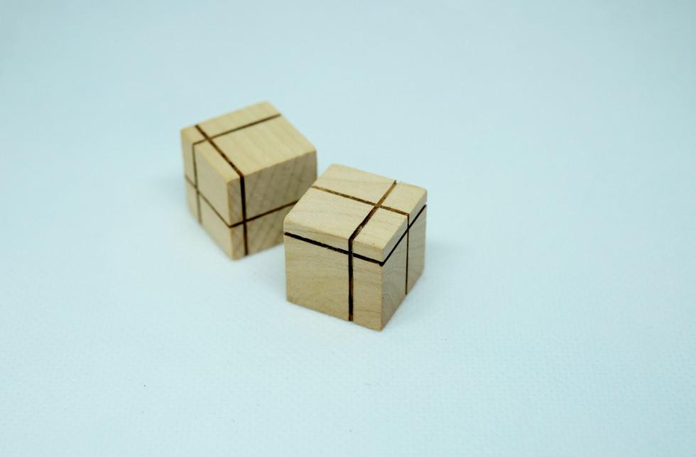 Wooden dice pair