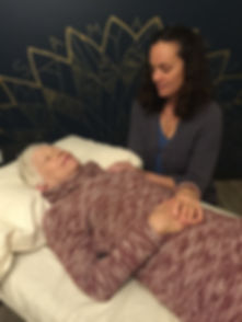 Photo of Jennifer offering Craniosacral therapy to a client