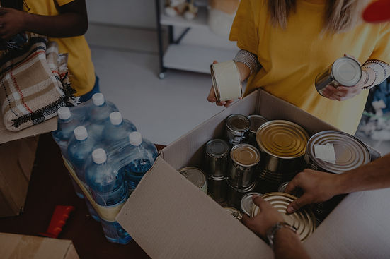 Photo of people volunteering at a food pantry