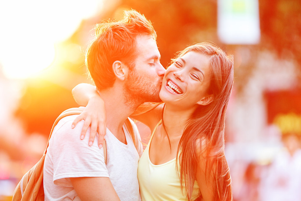 Couple kissing happiness fun. Interracia