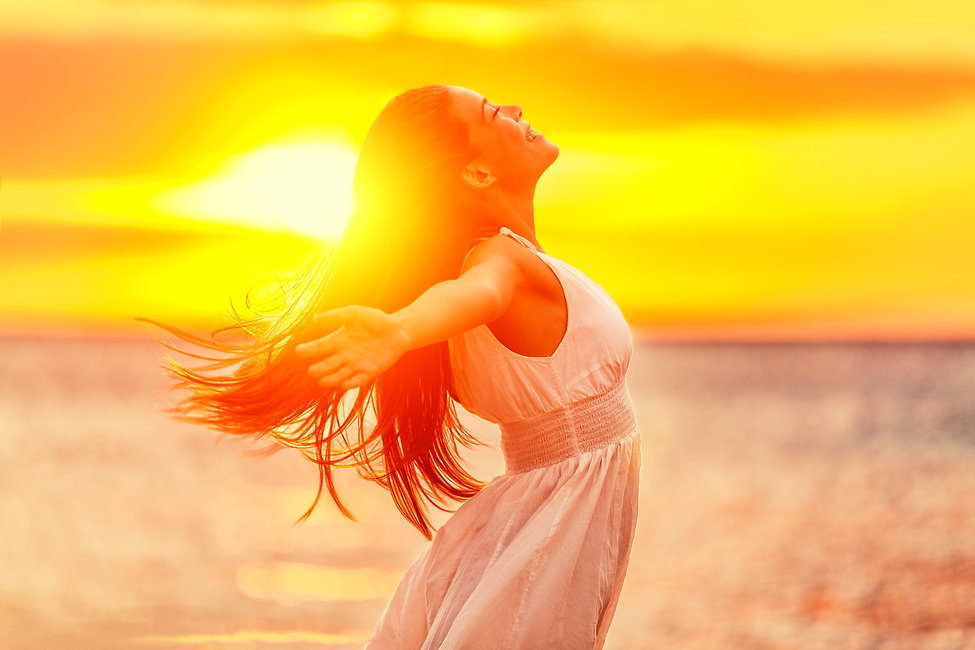 Happy woman feeling free with open arms