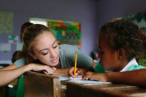 Voluntourists help with one on one tutoring