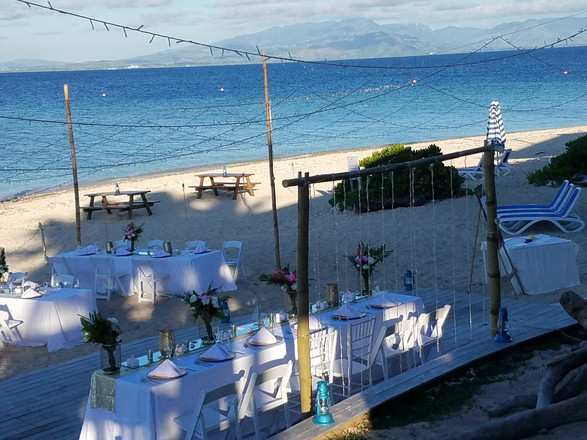 Beachfront dining in front of the pool
