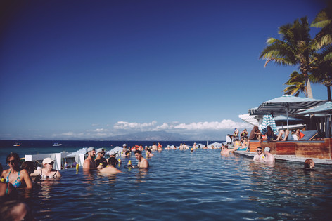 Guests enjoying the pool at a full island charter