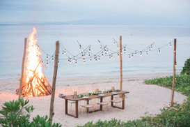 Intimate dining beachfront with bonfire