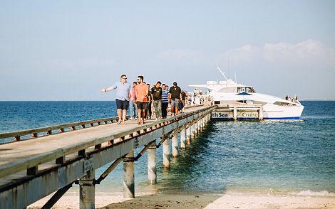 Arriving at Malamala Beach Club's famous jetty