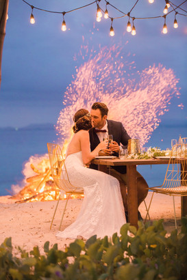 Beachfront dining with bonfire