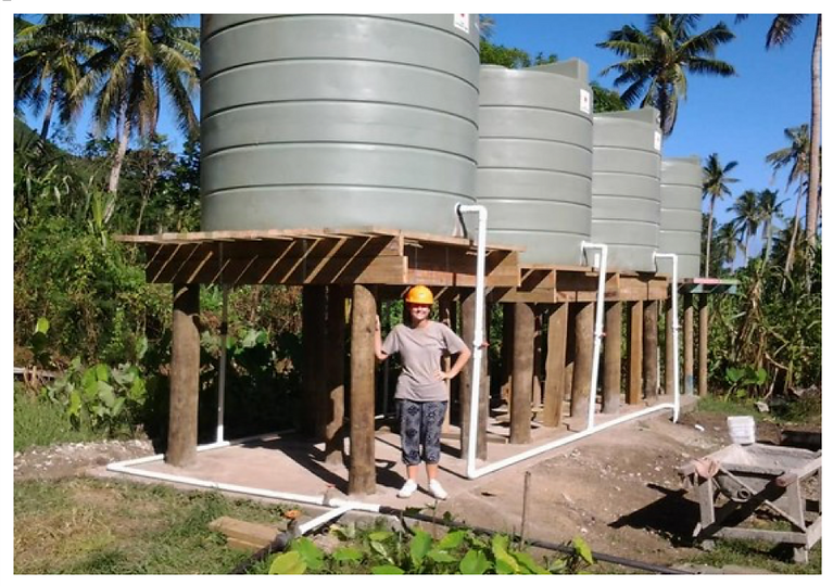 Installing water tanks - Vinaka Fiji