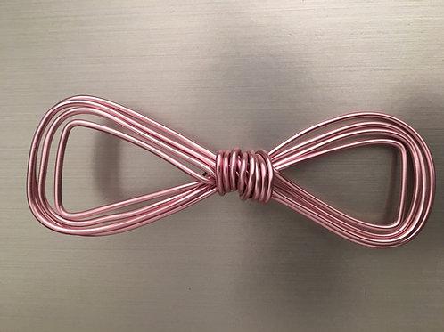 Noeud papillon courbé rose pastel