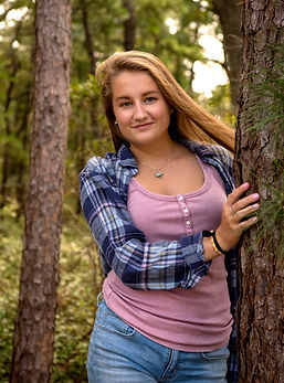 Portrait Photography Woman Standing Next to Tree