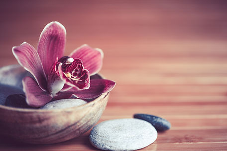 Flower and Rocks in Wooden Bowl