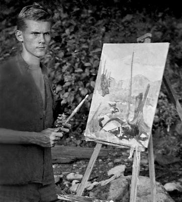 Robert Bateman at easel painting in Algonquin Park. c1948