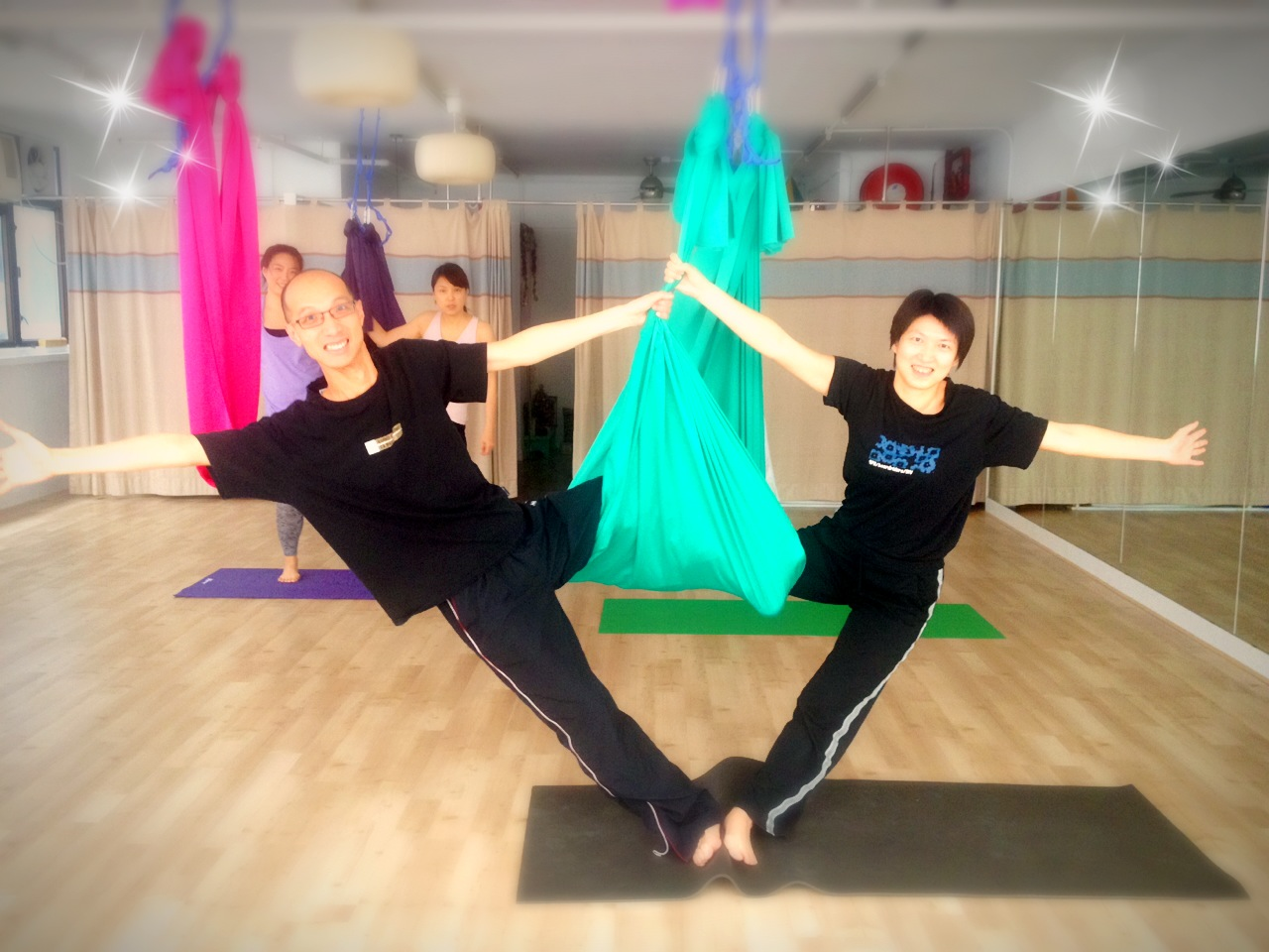Flying yoga class - Happy couple