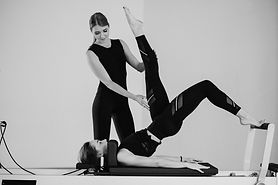 women-doing-pilates-reformer_1303-11677_
