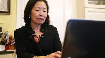 Dr. Kwan Kew Lai writing