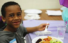 Boy eats spaghetti dinner