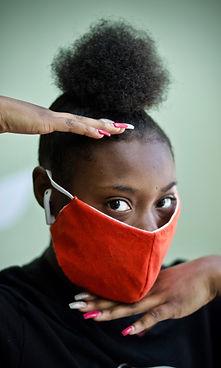 Teen girl posing with mask on