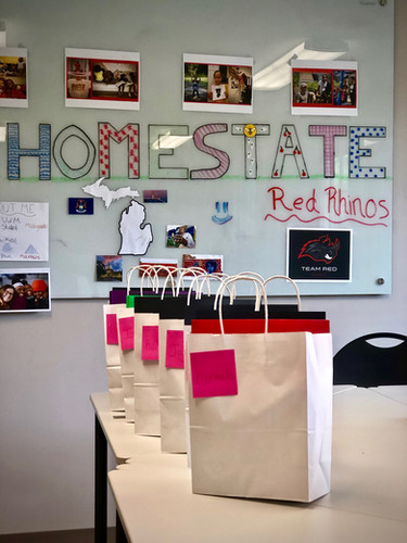 Homestate board with supply bags sent home to families each week
