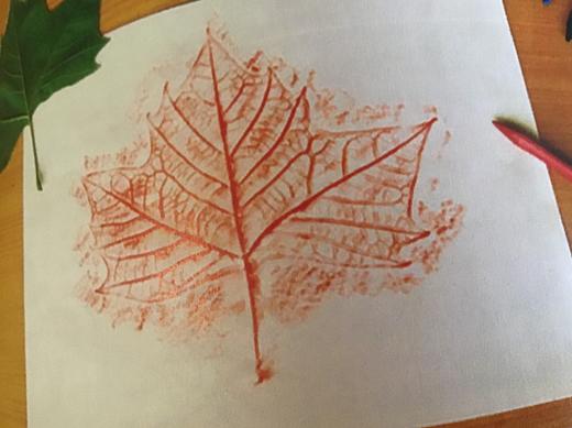Crayon rub over leaf