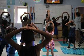 Children stretch on yoga mats