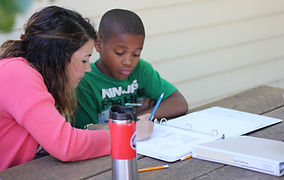 Mentor helps boy with homework